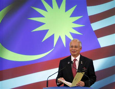 File picture shows Malaysia's Prime Minister Razak speaking at his office in Putrajaya outside Kuala Lumpur