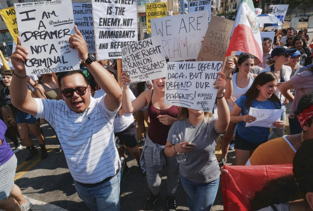 <p>Supporters of the Deferred Action for Childhood Arrivals, or DACA chant slogans and holds signs while joining a Labor Day rally in downtown Los Angeles on Monday, Sept. 4, 2017. (Photo: Richard Vogel/AP) </p>