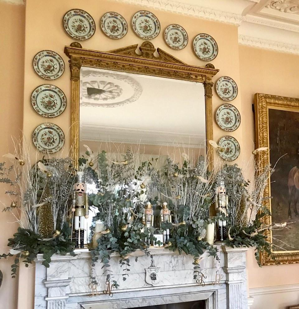 Silver branches, Nutcrackers, and glittered birds adorn our fireplace in the drawing room.
