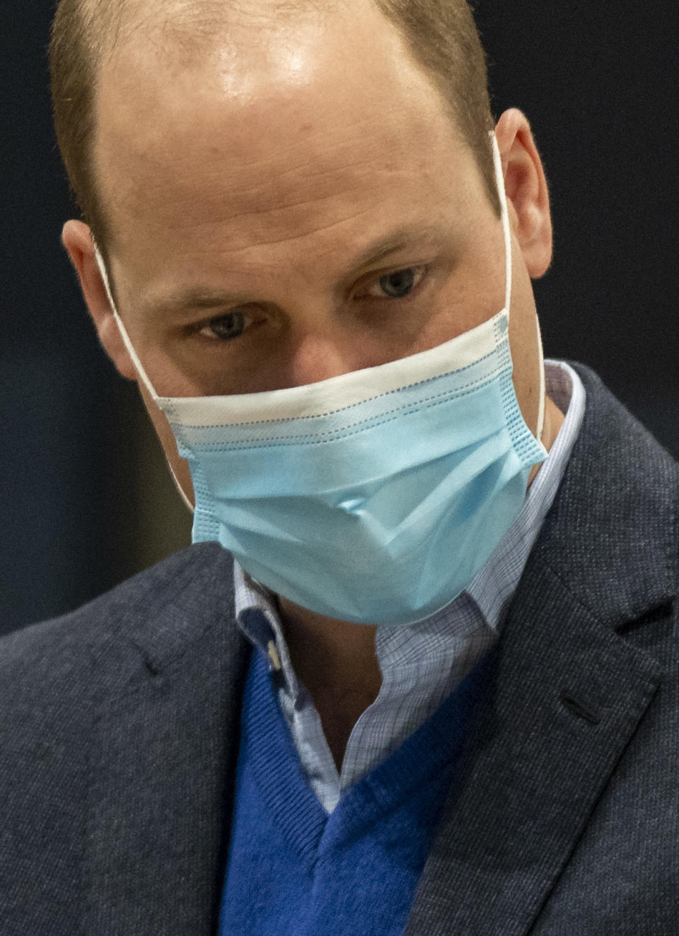 Britain's Prince William, Duke of Cambridge wears a face mask because of the pandemic as he visits a coronavirus vaccination centre at Kings Lynn Corn Exchange in King's Lynn, eastern England, on February 22, 2021. - Prince William spoke to NHS staff and volunteers about their experiences of being involved in the largest vaccination programme in British history. The Duke also met and spoke with a number of people receiving their vaccine that day.