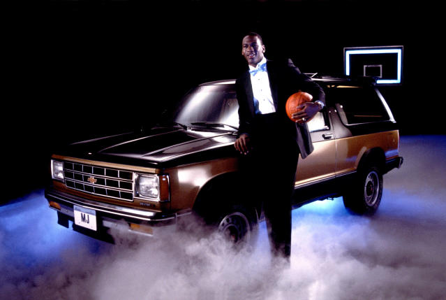 Michael Jordan poses with a Chevrolet Suburban dressed in a tuxedo, in Chicago, Illinois, in 1986. (Photo by Paul Natkin/Getty Images)