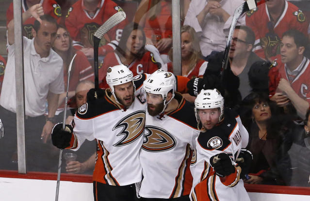 Anaheim Ducks left wing Patrick Maroon (19) celebrates his goal against against the Chicago Blackhawks with center Ryan Getzlaf (15) and defenseman Sami Vatanen (45) during the second period in Game 6 of the Western Conference finals of the NHL hockey Stanley Cup playoffs, Wednesday, May 27, 2015, in Chicago. (AP Photo/Charles Rex Arbogast)
