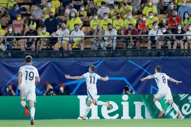 Atalanta's Remo Freuler (centre) celebrates after scoring in the Champions League against Villarreal