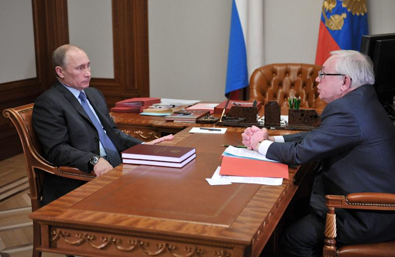 Russian President Vladimir Putin, left, and presidential human rights ombudsman Vladimir Lukin meet in the Bocharov Ruchei residence in the Black Sea resort of Sochi, Thursday, March 28, 2013.  Putin said the goal behind sweeping raids of non-government organizations in Russia, is to check their compliance with the law intended to stem foreign meddling in the nation's politics. (AP Photo/RIA-Novosti, Alexei Nikolsky, Presidential Press Service,Pool)