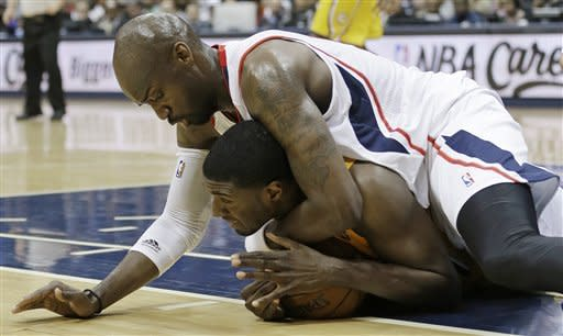 Indiana Pacers center Roy Hibbert (55) and Atlanta Hawks center Johan Petro (10) vie for a loose ball during the first half of an NBA first-round playoff basketball game in Atlanta, Friday, May 3, 2013. (AP Photo/John Bazemore)