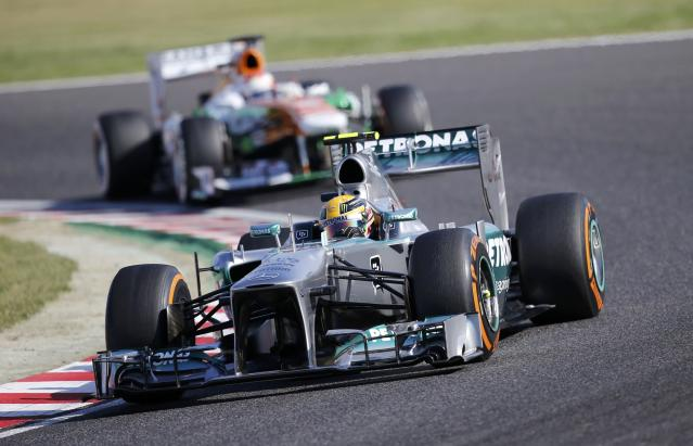 Mercedes Formula One driver Lewis Hamilton of Britain, followed by Force India Formula One driver Paul di Resta of Britain, drives during the qualifying session of the Japanese F1 Grand Prix at the Suzuka circuit October 12, 2013. REUTERS/Issei Kato (JAPAN - Tags: SPORT MOTORSPORT F1)