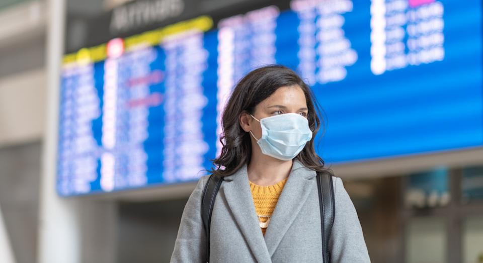Face masks are mandatory during all stages of taking a flight (Getty)