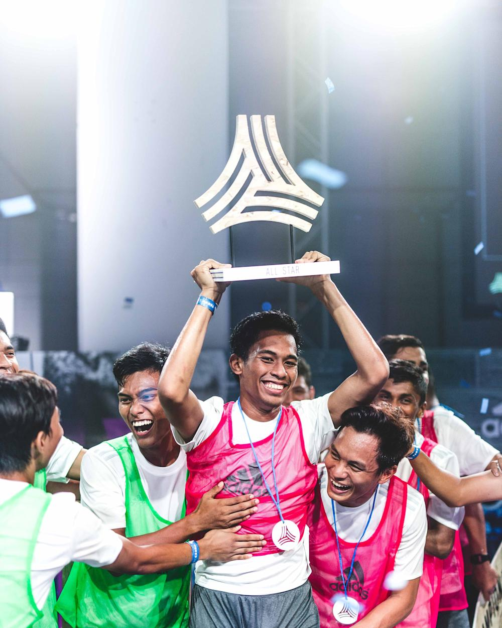 adidas Tango League Singapore MVP, Iqram Fiqri holding up his trophy among teammates