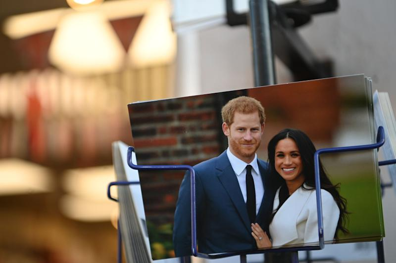 Royal memorabilia featuring Prince Harry and Duchess Meghan of Sussex on sale in a store near Buckingham Palace on Jan. 10, 2020.