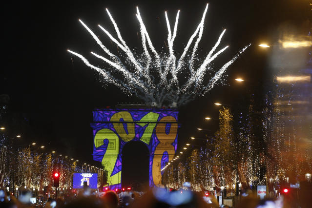 <p>A firework explodes over the Arc de Triomphe as part of the New Year celebrations on the Champs Elysees, in Paris, France, Monday, Jan. 1, 2018. (Photo: Thibault Camus/AP) </p>