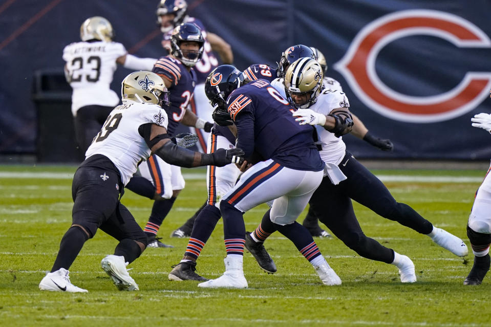 Chicago Bears quarterback Nick Foles (9) is sacked by New Orleans Saints defensive tackle Sheldon Rankins (98) and defensive end Brent Urban (92) in the first half of an NFL football game in Chicago, Sunday, Nov. 1, 2020. (AP Photo/Nam Y. Huh)