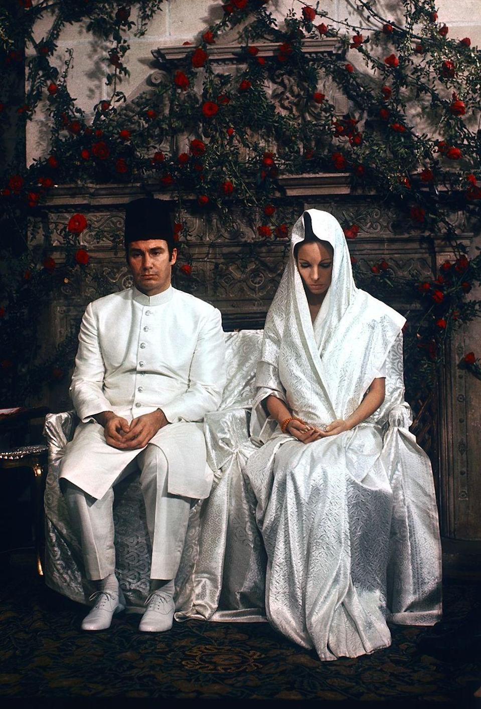 <p>British model Sally Croker-Poole wore an understated-yet-opulent sari in iridescent ivory for her wedding to Prince Shah Karim Al Hussaini, Aga Khan IV, a leader of Ismaili Muslims. </p>