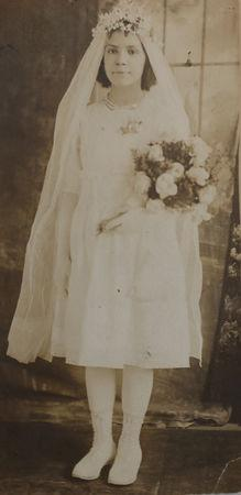 Marie Starace, about nine years old in this photograph from her First Communion, who lived in the borough of Brooklyn in 1918 when World War One ended, is seen in this picture from 1918, in New York, U.S., November 9, 2018. Courtesy of the Reinhold family/Handout via REUTERS