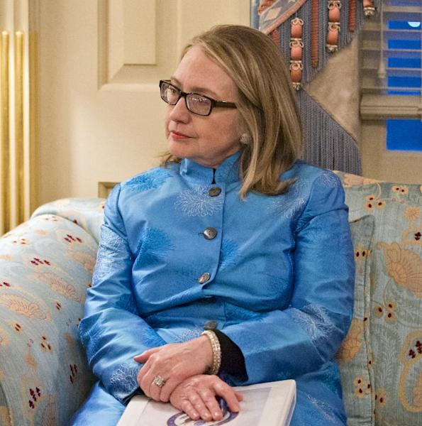Secretary of State Hillary Rodham Clinton holds a briefing book as she sits in her office suite at the State Department in Washington during meeting with Afghanistand President Hamid Karzai, Thursday, Jan. 10, 2013. (AP Photo/J. Scott Applewhite)