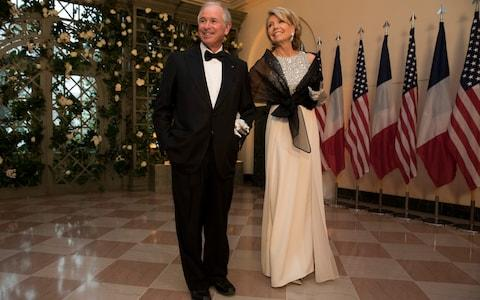 Stephen Schwarzman and his wife Christine arrive at the White House for a state dinner last year in Washington - Credit: Aaron P. Bernstein