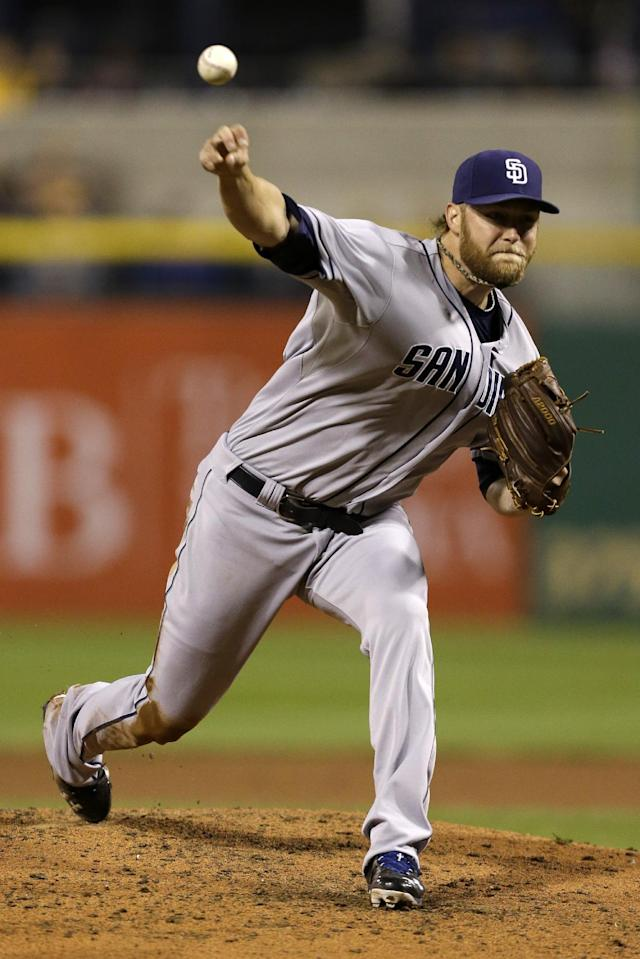 San Diego Padres starting pitcher Andrew Cashner delivers during the fifth inning of a baseball game against the Pittsburgh Pirates in Pittsburgh Monday, Sept. 16, 2013. (AP Photo/Gene J. Puskar)