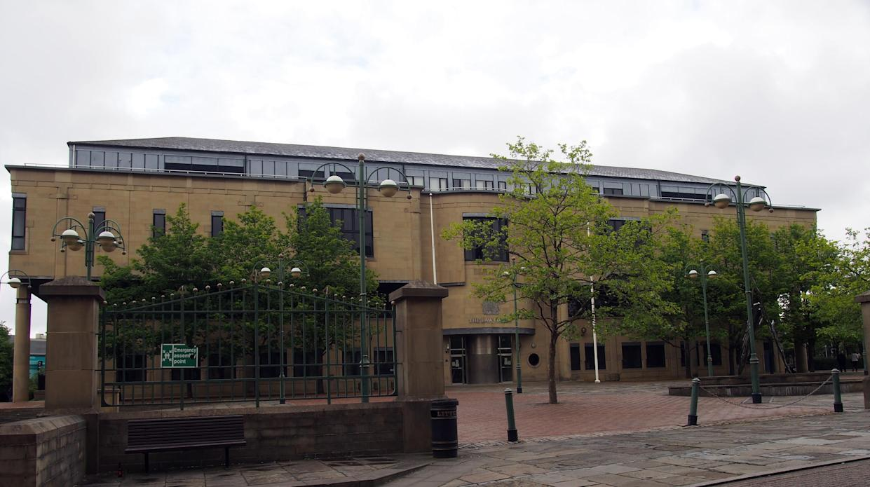 bradford, west yorkshire, united kingdom - 28 may 2019: a view of exchange square in bradford west yorkshire with the crown court building surrounded by trees