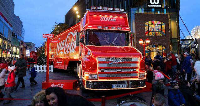 Shoppers pass the Coca-Cola truck in Liverpool City Centre. (Photo by Peter Byrne/PA Images via Getty Images)