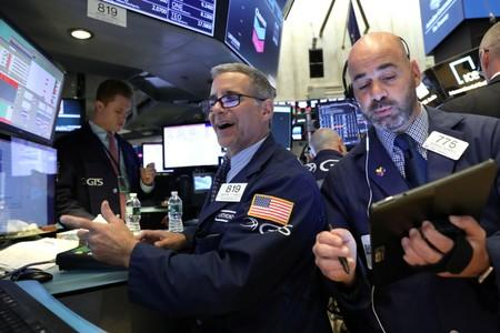 Fed rate-cut sign boosts stocks, dollar drops
