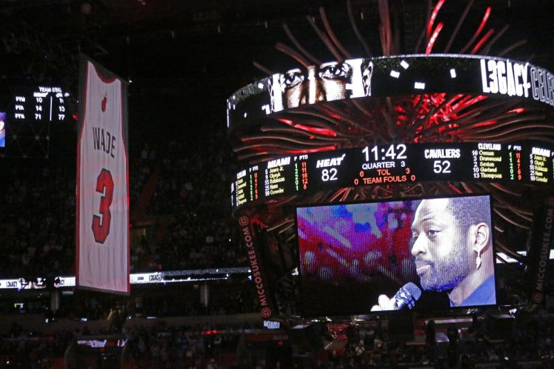 Former Miami Heat guard Dwyane Wade is seen on a video screen as his jersey number is raised at halftime of an NBA basketball game between the Heat and the Cleveland Cavaliers on Saturday, Feb. 22, 2020, in Miami. (David Santiago/Miami Herald via AP)