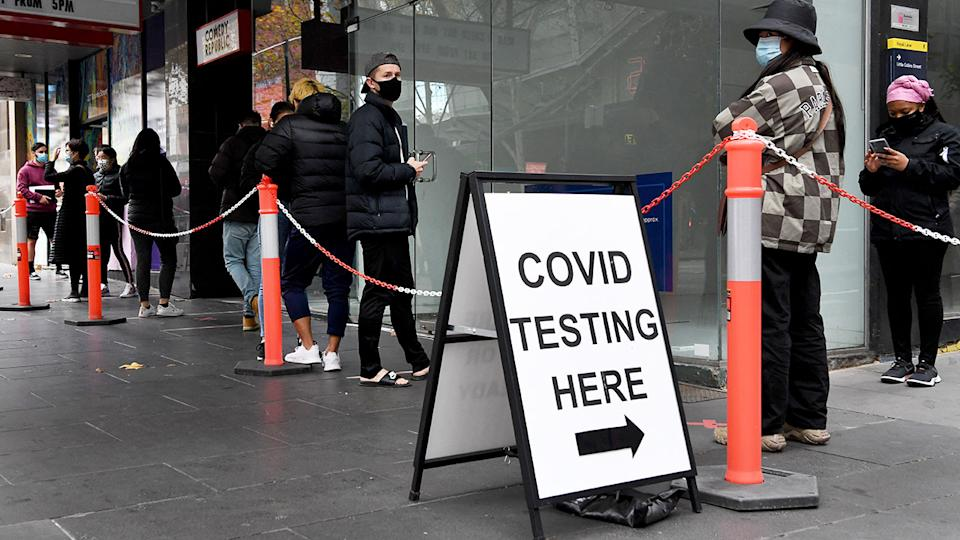 People, pictured here queuing at a Covid-19 testing station in Melbourne.