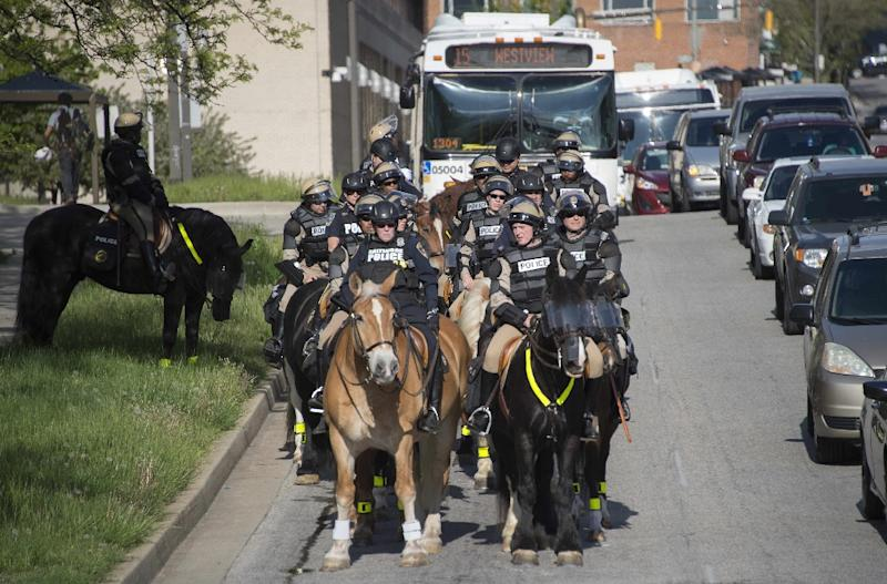 Mounted Baltimore police in riot gear watch as demonstrators march through the streets of Baltimore, Maryland, May 2, 2015 (AFP Photo/Jim Watson)