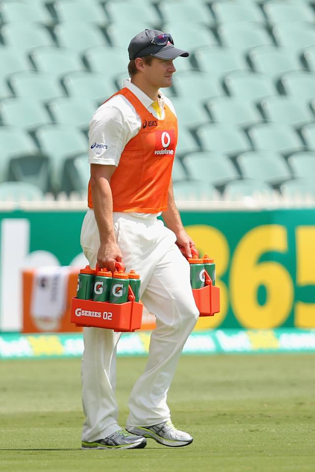ADELAIDE, AUSTRALIA - NOVEMBER 26: Injured Australian player Shane Watson carries drinks onto the field during day five of the Second Test Match between Australia and South Africa at Adelaide Oval on November 26, 2012 in Adelaide, Australia.  (Photo by Cameron Spencer/Getty Images)