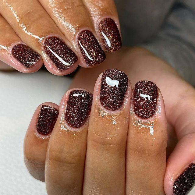 """<p>We tend to think of rose gold paired with soft pink, but this rich brown and gold manicure by <a href=""""https://www.instagram.com/charlbbeauty/?utm_source=ig_embed"""" rel=""""nofollow noopener"""" target=""""_blank"""" data-ylk=""""slk:Charlotte Burris"""" class=""""link rapid-noclick-resp"""">Charlotte Burris</a> looks set to change that.</p><p><a href=""""https://www.instagram.com/p/CHF0fvTgWeT/?utm_source=ig_web_copy_link"""" rel=""""nofollow noopener"""" target=""""_blank"""" data-ylk=""""slk:See the original post on Instagram"""" class=""""link rapid-noclick-resp"""">See the original post on Instagram</a></p>"""