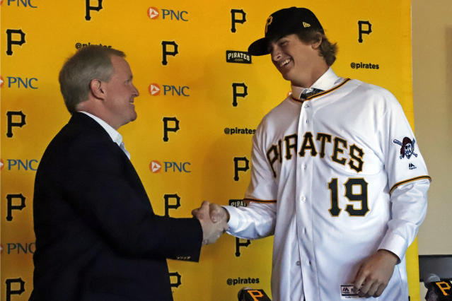 Pittsburgh Pirates first-round draft pick, Quinn Priester, a right-handed pitcher out of Cary-Grove High School in Cary, Illinois, right, shakes hands with Pittsburgh Pirates general manager Neil Huntington after signing with the team at PNC Park in Pittsburgh, Tuesday, June 11, 2019. (AP Photo/Gene J. Puskar)
