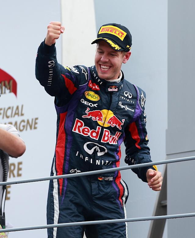 Red Bull Racing's Sebastian Vettel celebrates on the podium after victory in the Italian Grand Prix and the Autodromo Nazionale Monza, Monza, Italy.