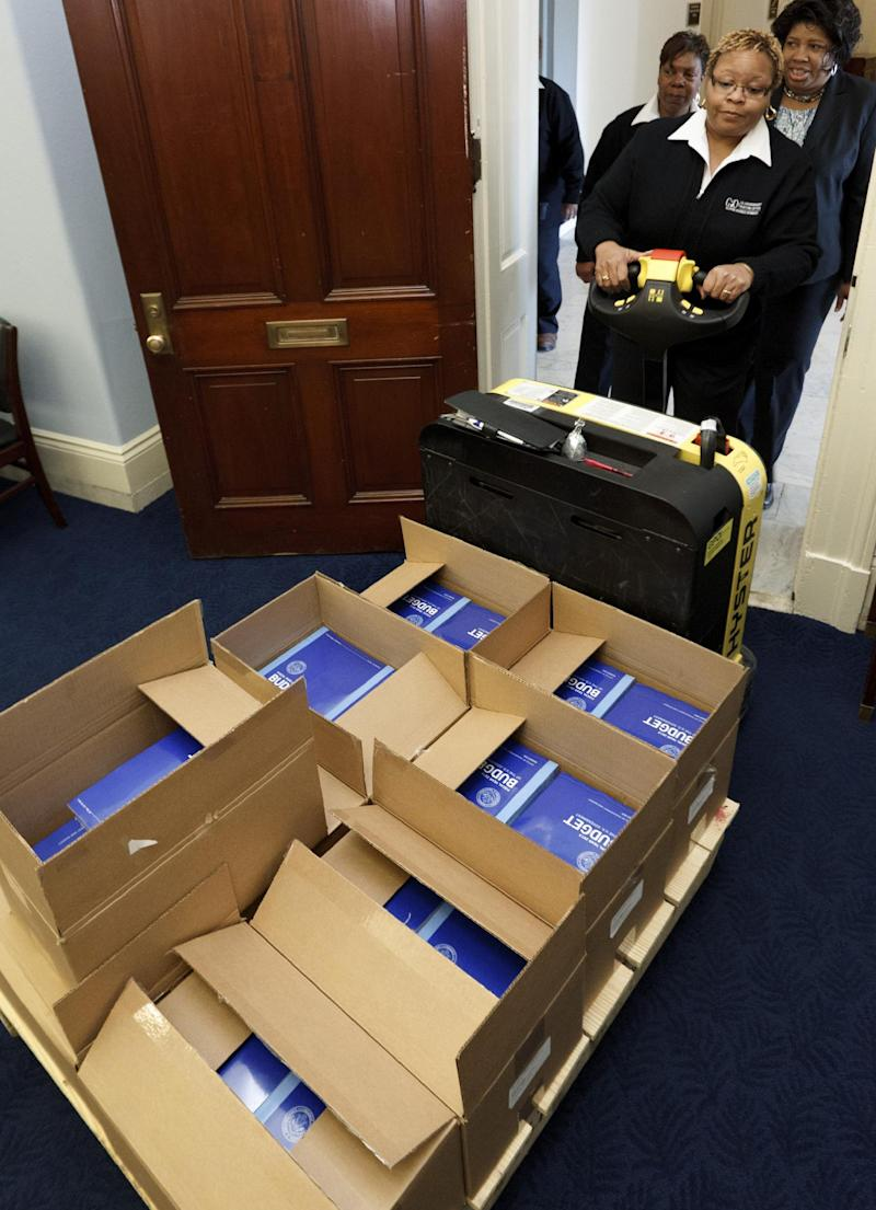 Copies of President Barack Obama's fiscal 2013 federal budget arrive at the House Budget Committee on Capitol Hill in Washington, Monday, Feb. 13, 2012.  (AP Photo/J. Scott Applewhite)