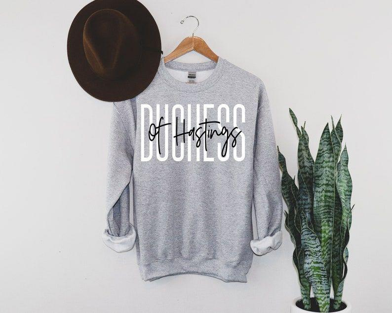 """<p><strong>SocialLook</strong></p><p>Etsy</p><p><strong>$32.36</strong></p><p><a href=""""https://go.redirectingat.com?id=74968X1596630&url=https%3A%2F%2Fwww.etsy.com%2Flisting%2F941203979%2Fduchess-of-hastings-bridgerton%3Fvariation0%3D1752579591&sref=https%3A%2F%2Fwww.goodhousekeeping.com%2Fholidays%2Fgift-ideas%2Fg37622708%2Fbridgerton-gifts%2F"""" rel=""""nofollow noopener"""" target=""""_blank"""" data-ylk=""""slk:Shop Now"""" class=""""link rapid-noclick-resp"""">Shop Now</a></p><p>Sweater weather is calling and this athletic-fit piece is picking up the phone. Not only is this Duchess of Hastings sweater oh-so perfect for the colder months, but it's pre-shrunk and can be thrown in the dryer. That's what we call a triple win! </p>"""