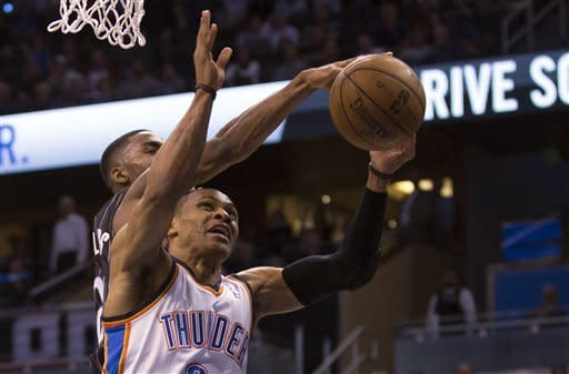 Oklahoma City Thunder's Russell Westbrook, front, has his shot blocked by Orlando Magic's Maurice Harkless, back, during the second half of an NBA basketball game on Friday, March 22, 2013, in Orlando, Fla. The Thunder won 97-89. (AP Photo/Willie J. Allen Jr.)