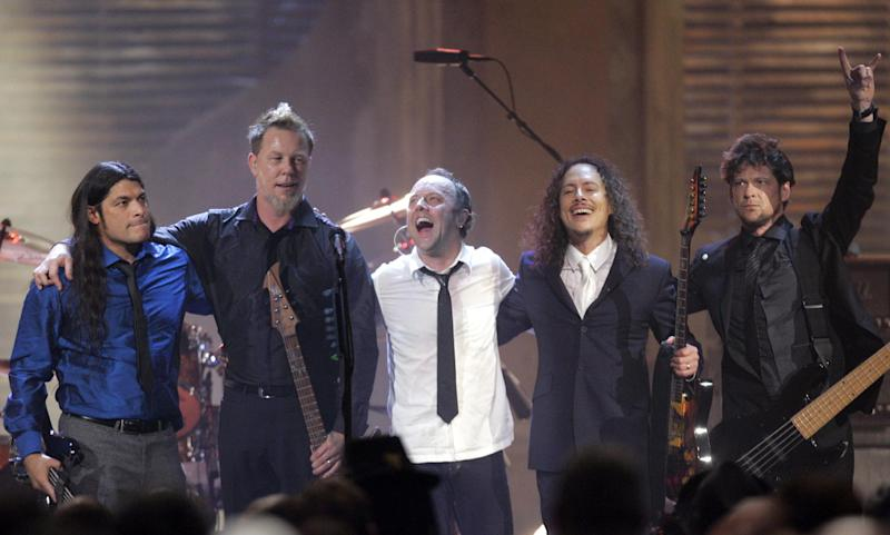 FILE - This April 4, 2009 file photo shows the band Metallica, from left, Robert Trujillo, James Hetfield, Lars Ulrich, Kirk Hammett and Jason Newsted, after being inducted into the Rock and Roll Hall of Fame at the 2009 Rock and Roll Hall of Fame Induction Ceremony in Cleveland. (AP Photo/Tony Dejak, file)