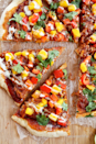 """<p><span>Any pizza fan will drool over this healthy version. The </span><a href=""""http://www.drozthegoodlife.com/healthy-food-nutrition/healthy-recipe-ideas/recipes/a1122/sauteed-spinach-with-mango/"""" rel=""""nofollow noopener"""" target=""""_blank"""" data-ylk=""""slk:sweet taste from the mango"""" class=""""link rapid-noclick-resp"""">sweet taste from the mango</a><span> mixed with BBQ jackfruit is pure perfection.</span></p><p>Grab the recipe from <a href=""""http://mydarlingvegan.com/2014/07/bbq-pulled-pork-pizza-with-mango-salsa/"""" rel=""""nofollow noopener"""" target=""""_blank"""" data-ylk=""""slk:My Darling Vegan"""" class=""""link rapid-noclick-resp"""">My Darling Vegan</a>.</p>"""