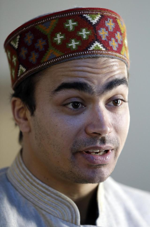 India's Shiva Keshavan speaks at a luncheon at the 2014 Winter Olympics, Tuesday, Feb. 11, 2014, in Sochi, Russia. Keshavan competed in the men's singles luge under the Olympic flag because India's Olympic body had been suspended by the IOC in 2012 over a corruption scandal. The IOC executive board reinstated the Indian Olympic body on Tuesday, Feb. 11, 2014, after it held a weekend ballot that complied with ethics rules barring corruption-tainted officials from running for election. (AP Photo/Morry Gash)