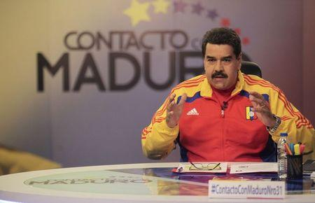 "Venezuela's President Nicolas Maduro speaks during his weekly broadcast ""en contacto con Maduro"" (In contact with Maduro) at the Miraflores Palace in Caracas"