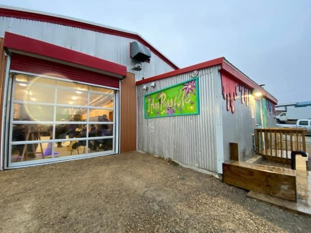 The new Red Fish Arts studio has opened at what was the fish plant in the 1950s and aims to teach community members a mixture of welding and other art. It is funded in part by the Arctic Inspiration Prize won by Nunavut youth in 2018. (Submitted by Marla Limousin - image credit)