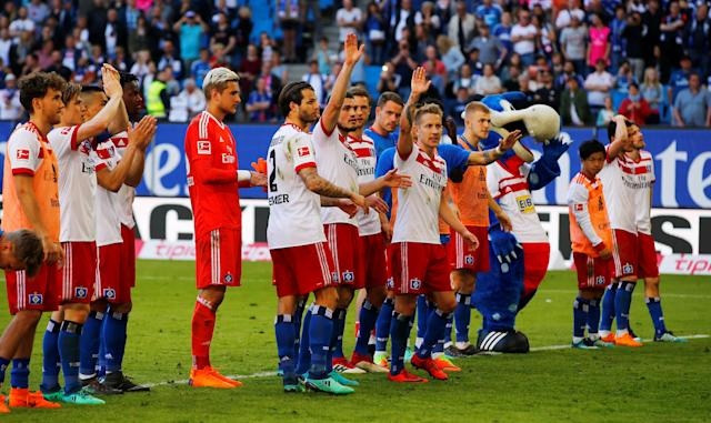 Soccer Football - Bundesliga - Hamburger SV vs SC Freiburg - Volksparkstadion, Hamburg, Germany - April 21, 2018 Hamburg players celebrate after the match REUTERS/Morris Mac Matzen DFL RULES TO LIMIT THE ONLINE USAGE DURING MATCH TIME TO 15 PICTURES PER GAME. IMAGE SEQUENCES TO SIMULATE VIDEO IS NOT ALLOWED AT ANY TIME. FOR FURTHER QUERIES PLEASE CONTACT DFL DIRECTLY AT + 49 69 650050