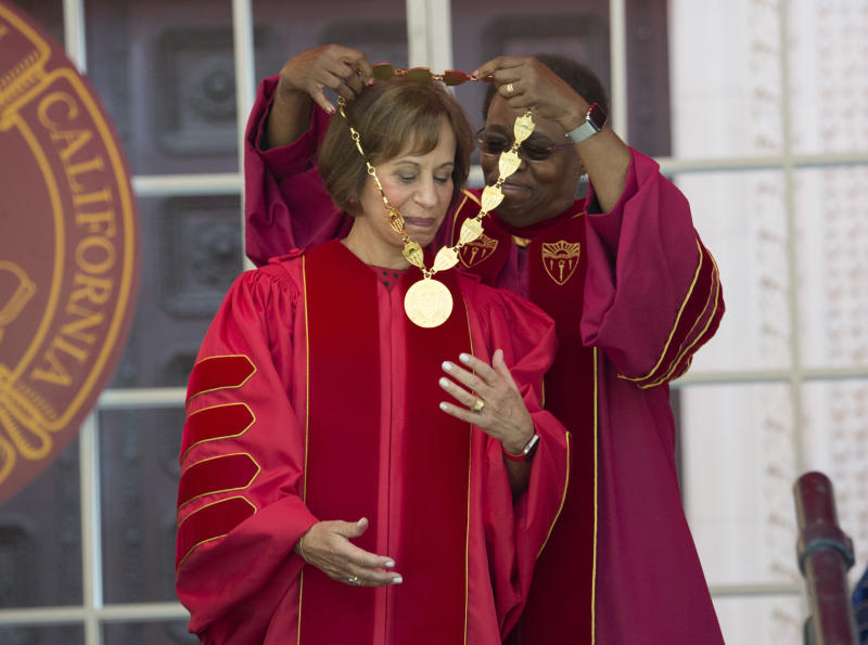 IMAGE DISTRIBUTED FOR USC -  Interim USC President Wanda Austin, right, bestows the Medal of Office during Carol L. Folt's inauguration ceremony on Friday Sept. 20, 2019 in Los Angeles. (Phil McCarten/AP Images for USC)