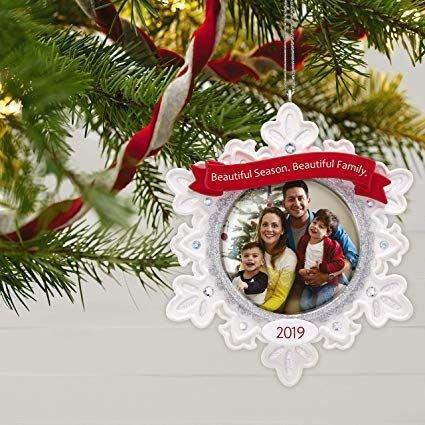 "<p><strong>BUY IT: $12.99; <a href=""https://www.amazon.com/Hallmark-Keepsake-Christmas-Beautiful-Snowflake/dp/B07NDGLYCX/ref=as_li_ss_tl?ie=UTF8&camp=1789&creative=9325&linkCode=as2&creativeASIN=B07NDGLYCX&tag=southlivin04-20&ascsubtag=d41d8cd98f00b204e9800998ecf8427e"" target=""_blank"">amazon.com</a></strong></p> <p>Mark each Christmas by hanging a personalized photo ornament on your tree.</p>"
