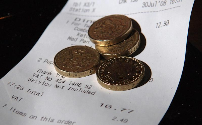 EMBARGOED TO 0001 THURSDAY JULY 31, 2008. Money in a tray as tips in bars and restaurants will no longer be counted towards the pay of staff to bring them up to the minimum wage, the Government announced today.