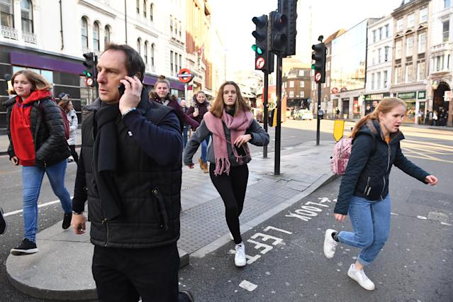 People running away from Borough Market in London after police to them to leave the area. Photo: PA