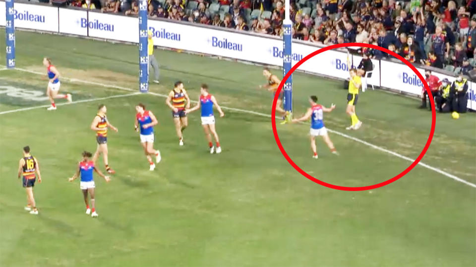 Umpires, pictured here calling a throw in rather than deliberate out-of-bounds.