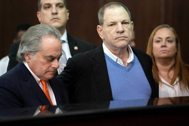Film producer Harvey Weinstein stands with his lawyer Benjamin Brafman (L) inside Manhattan Criminal Court during his arraignment in Manhattan, May 25, 2018.