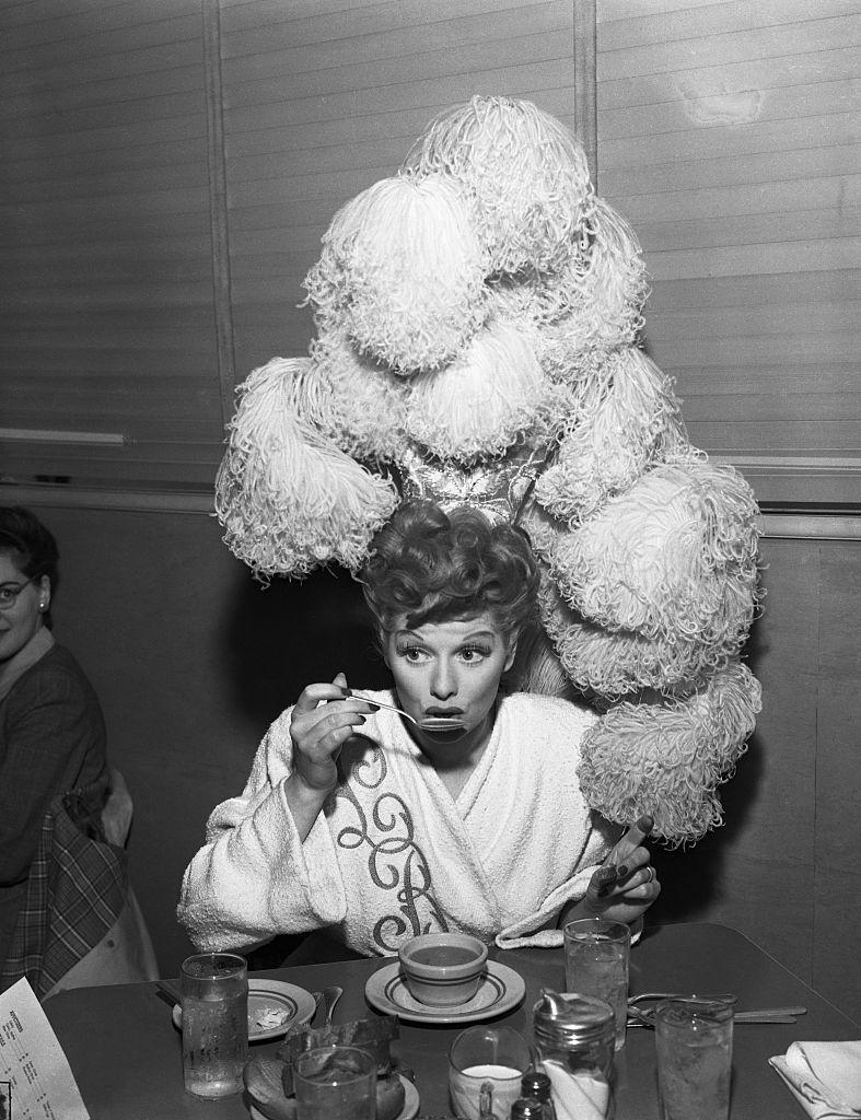 <p>Lucille appeared in the MGM film<em> Ziegfeld Follies </em>and attempted to take her lunch break without removing her elaborate ostrich feather costume. </p>