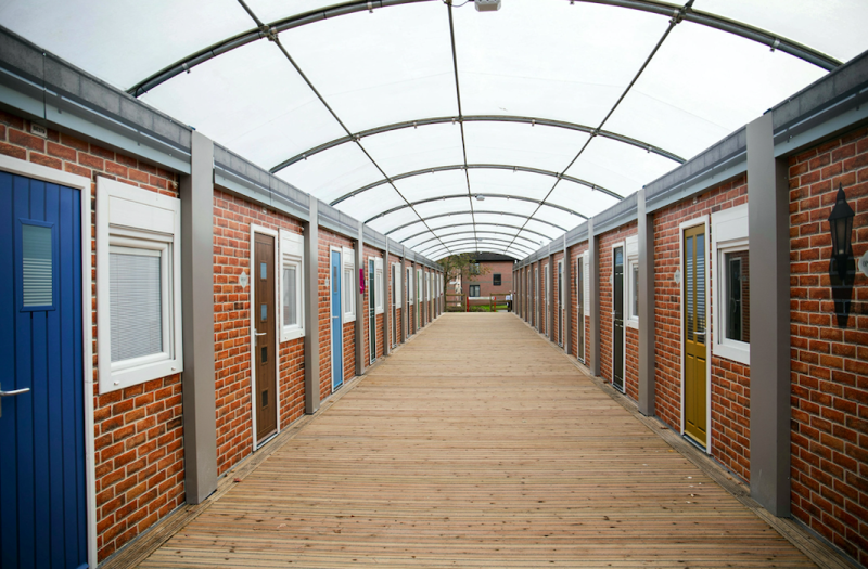 The studio pods are costing residents £150 per week (SWNS)