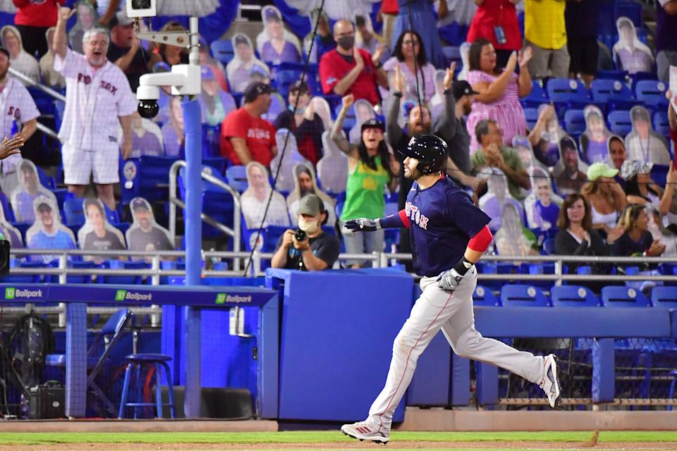 DUNEDIN, FLORIDA - MAY 20: J.D. Martinez #28 of the Boston Red Sox rounds the bases after hitting a two run home run off of Rafael Dolis #41 of the Toronto Blue Jays in the ninth inning at TD Ballpark on May 20, 2021 in Dunedin, Florida. (Photo by Julio Aguilar/Getty Images)
