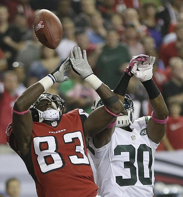 Atlanta Falcons wide receiver Harry Douglas (83) misses a catch in the end zone as New York Jets cornerback Darrin Walls (30) defends during the second half of an NFL football game, Monday, Oct. 7, 2013, in Atlanta. (AP Photo/John Bazemore)