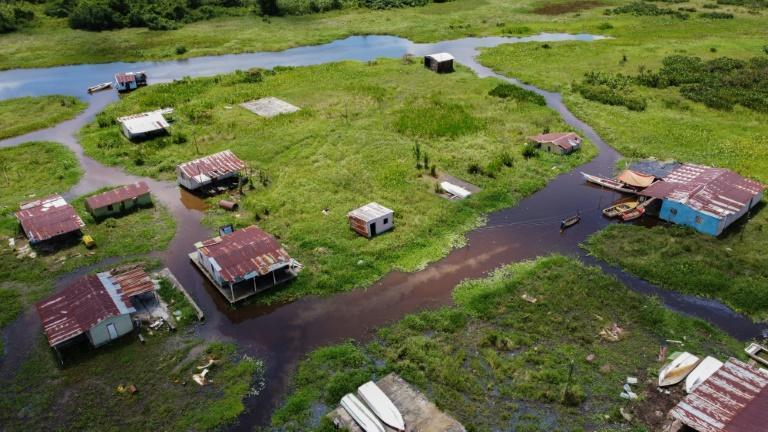 An aerial view of Congo Mirador makes it seem like the village is in the middle of a green field, not in the water (AFP/Federico PARRA)